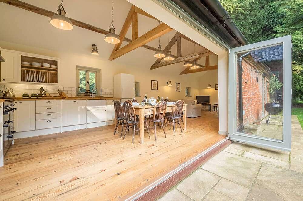 Bi-fold doors opening on to Bear's Cottage kitchen