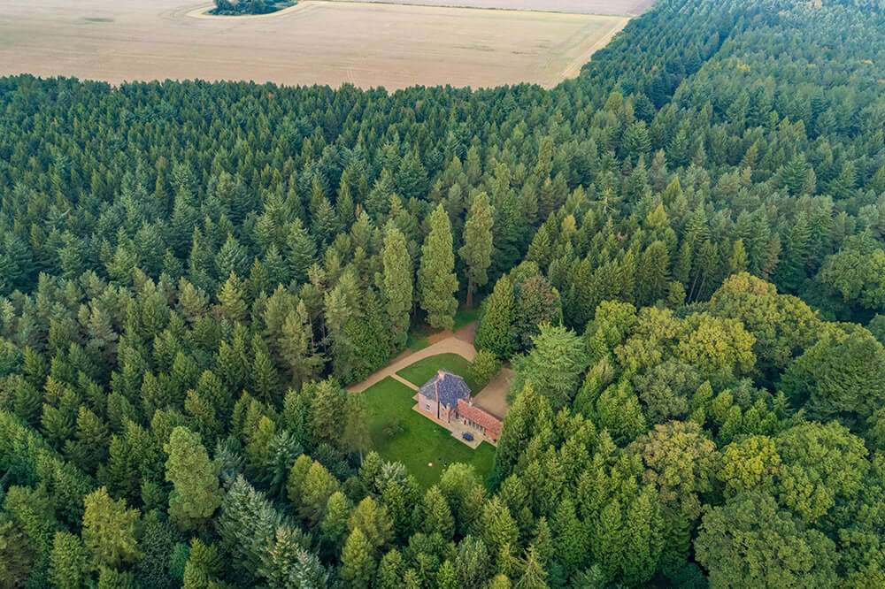 Aerial view of Bear's Cottage, a beautifully secluded woodland holiday cottage in rural Norfolk