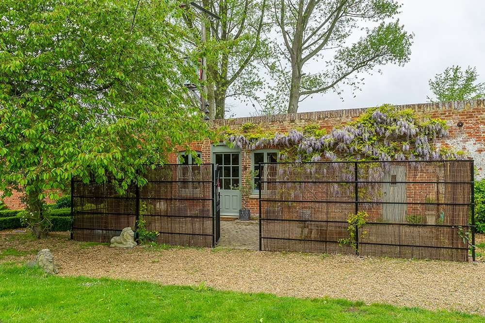 The Potting Shed garden leads out into the walled garden