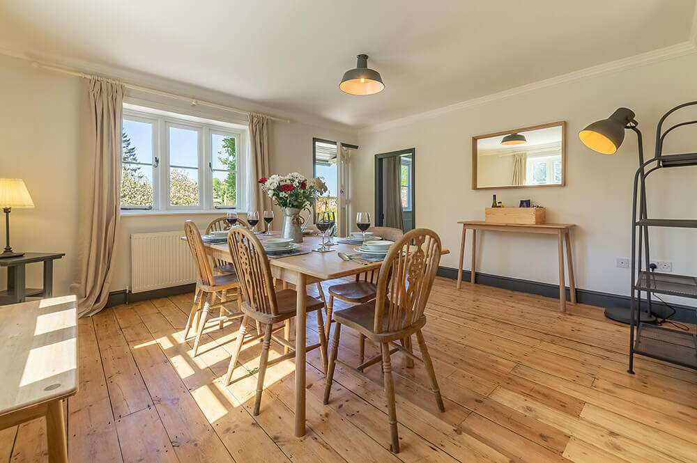 The dining room at Park Cottage leads out onto the secluded garden