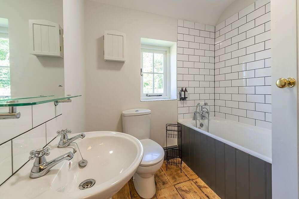 Sleek bathroom at Park Cottage luxury holiday cottage in Norfolk