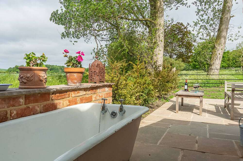 The outside bath at the Potting Shed in Norfolk - a fun alternative to a private hot tub!