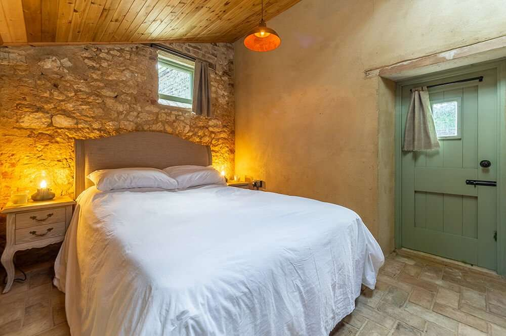 The cosy, romantic bedroom at the Potting Shed in Norfolk