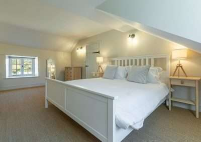 Spacious double bedroom at Market Square House, a luxurious holiday cottage in north Norfolk