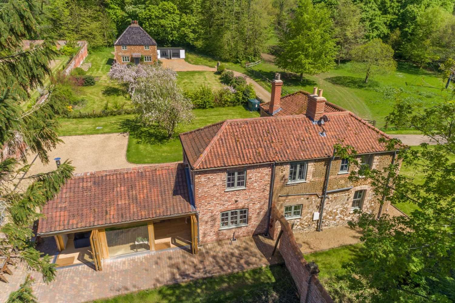 Aerial view of the Walled Garden Cottages, perfect for large family holidays to Norfolk
