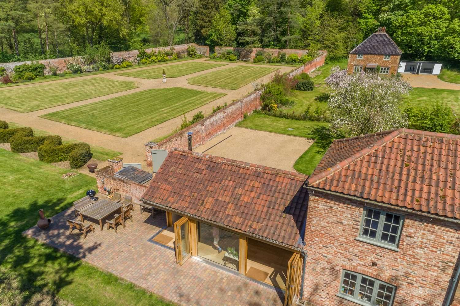 Aerial view of the walled garden and country estate holiday cottages at Fring in Norfolk