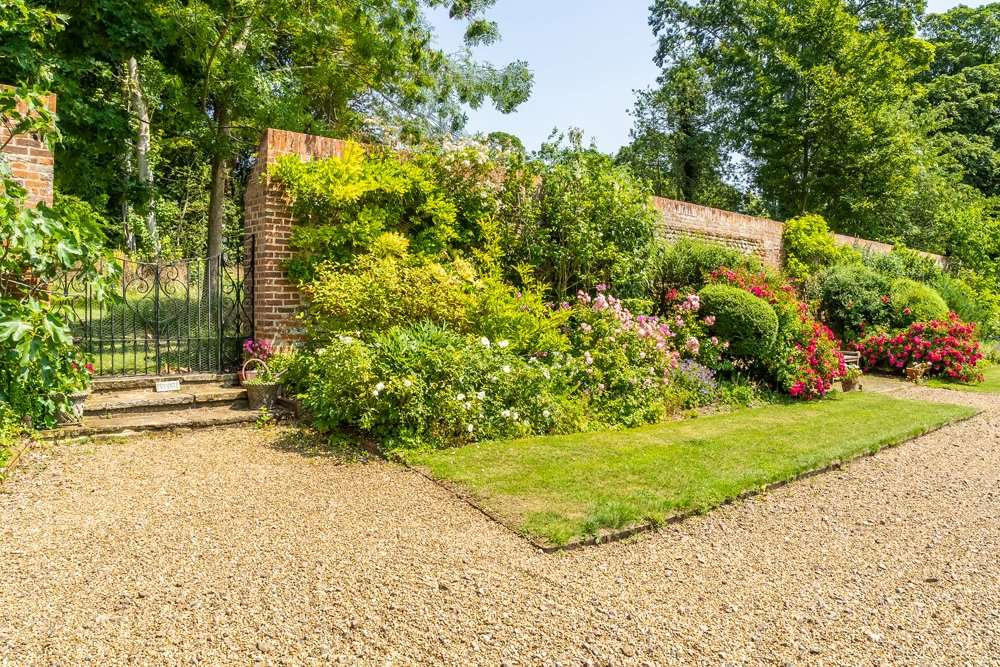 Image shows the beautiful floral garden surroundings at Fring Estate