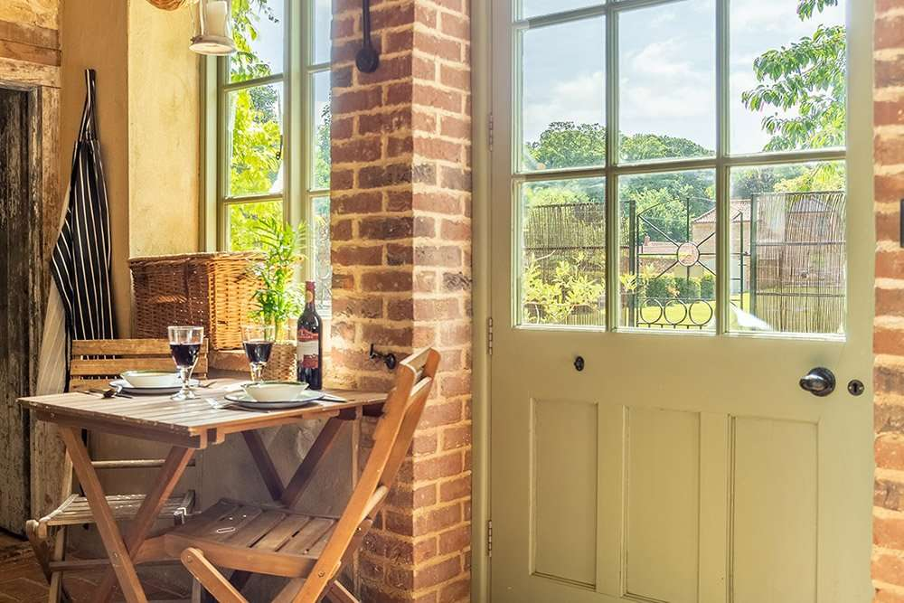 The rustic interior of the Potting Shed, a romantic getaway in Norfolk